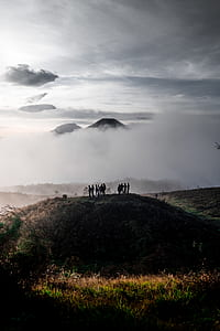 group of person on top of mountain