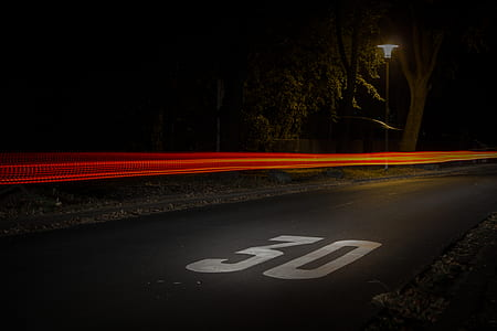 Time Lapse Photography of Red and Orange Light on Road With 30 Print on Nighttime