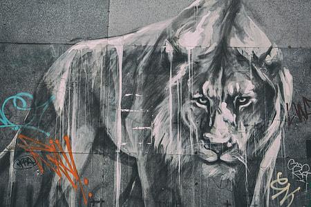 Wide angle shot of street art lion and graffiti,