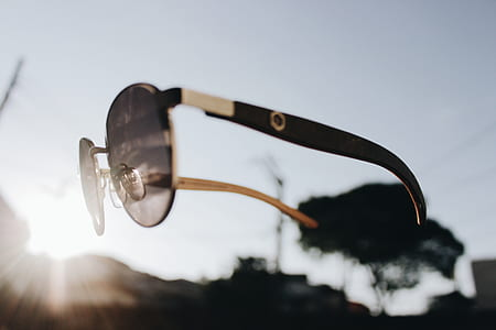 shallow focus of brown sunglasses