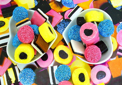 photo of yellow, pink, and blue candies