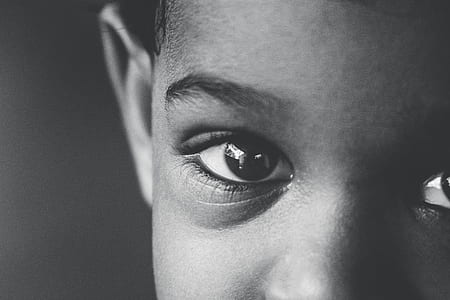 grayscale photo of toddler's face