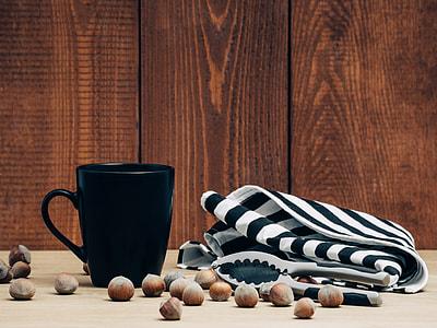 black ceramic mug and white and black textile