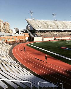human running on track field