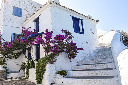 white and blue painted concrete house with side stairs