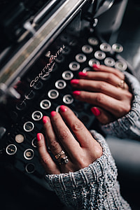 Woman typing on an old typewriter