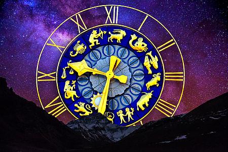 round blue and gold analog clock