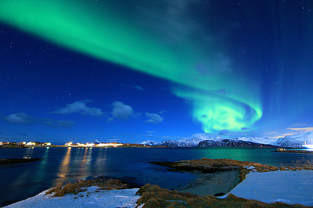 northern lights over the sky during twilight