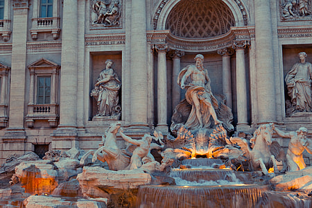 An early evening shot of the architectural details of the world-famous Trevi Fountain statue in Rome, Italy