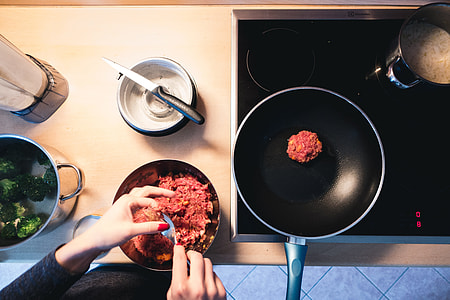 Frying ground beef burger meat