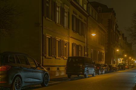 Cars in Illuminated City at Night