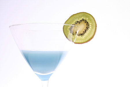 sliced kiwi on clear martini glass