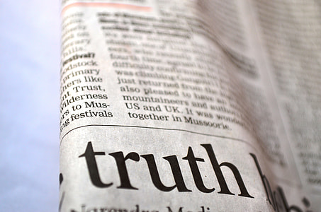 closeup photo of newspaper print showing Truth text