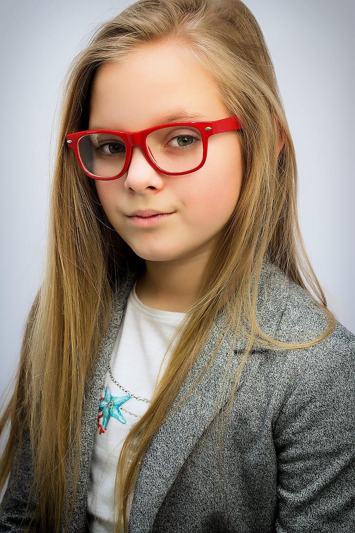girl in gray blazer wearing red wayfarer eyeglasses