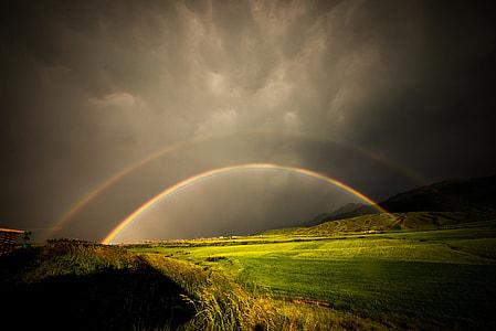 rainbow on grass field