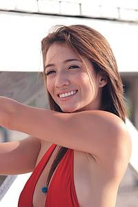 woman in red bikini top