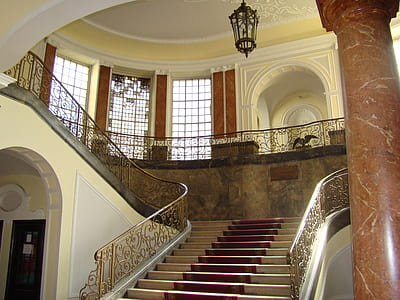 photo of white and brown staircase inside white room