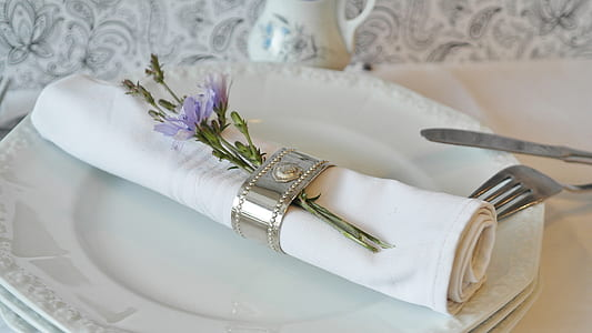 table napkin on plate with flowers