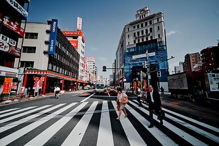 people waking on pedestrian lane
