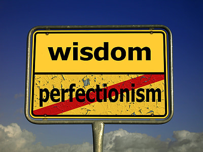 photo of yellow and black Wisdom signboard