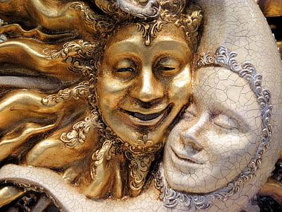sun and half-moon statuette