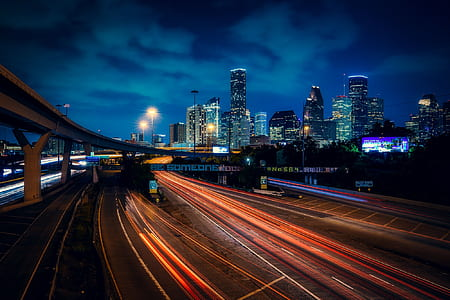 time lapse photography of car lights on street road during night time