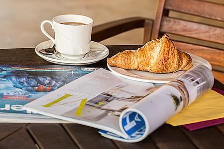 croissant on white ceramic plate
