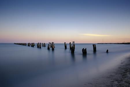 gray post on seashore