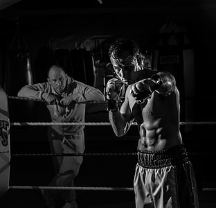 grayscale photo of boxer on top of ring