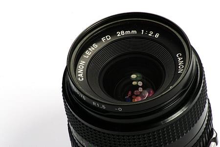 black Canon Lens FD 28mm 1:2.8 camera lens