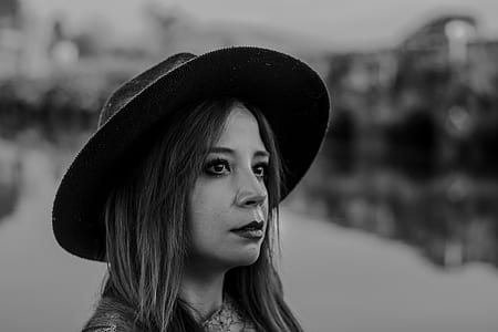 Woman in Black Hat Taken Photo