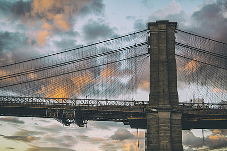 A shot of the famous Brooklyn Bridge in New York, this image was captured at sunset from Dumbo in Brooklyn