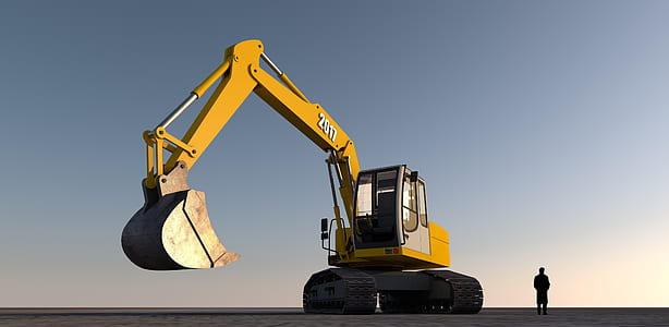 man standing next to excavator