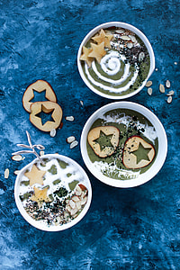 three round white ceramic bowls filled with food