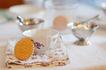 white and purple flower print ceramic tea cup