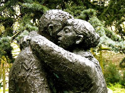 woman hug to man statue