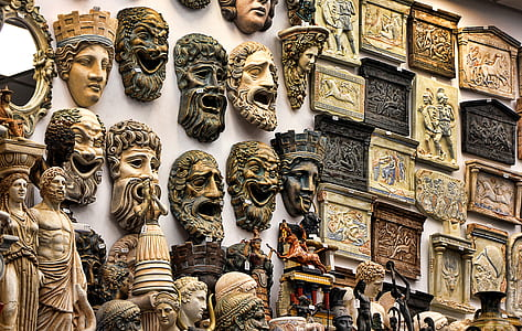 assorted head figurines and wall art decors