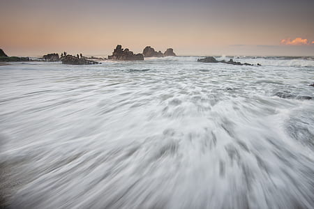 time lapse photography of body of water waves