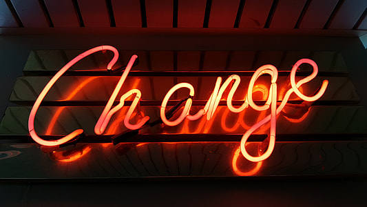 close up photo of red Change neon light signage