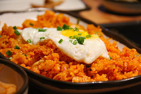 fried rice with sunny side up egg with onion leaves