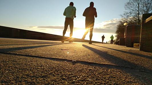 photo of two man running
