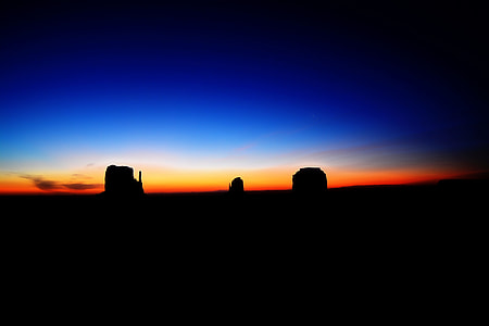 silhouette of rocks after sunset
