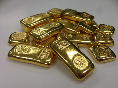gold bar lot on white surface
