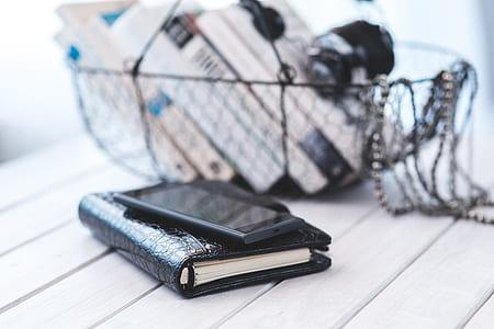 Elegant black notebook with mobile phone