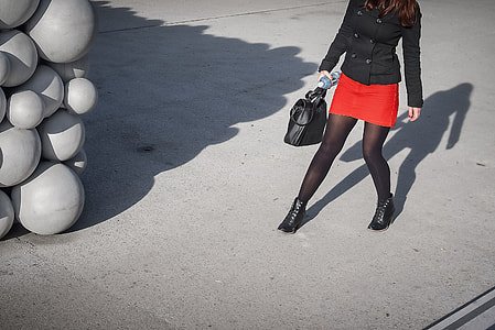 A girl in a bright red dress on the streets of Linz in Austria. Image captured with a Leica