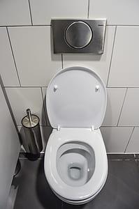 opened white ceramic toilet bowl