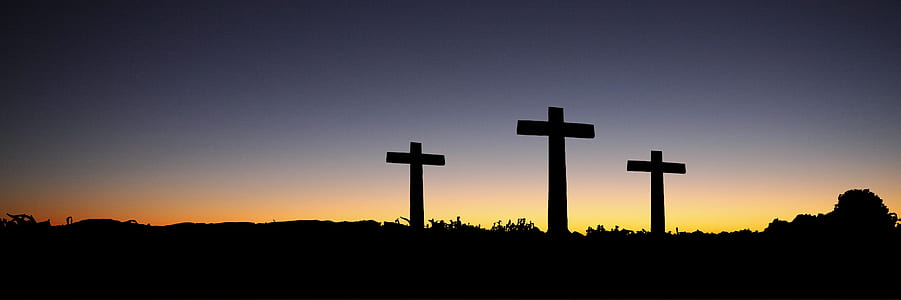 Landscape View of 3 Cross Standing during Sunset