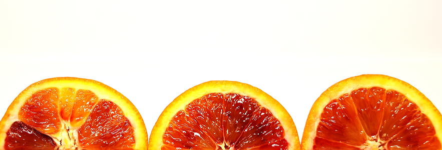 three sliced citrus fruits