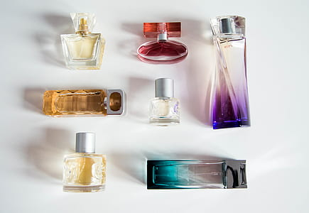flat-lay photography of fragrance bottle lot