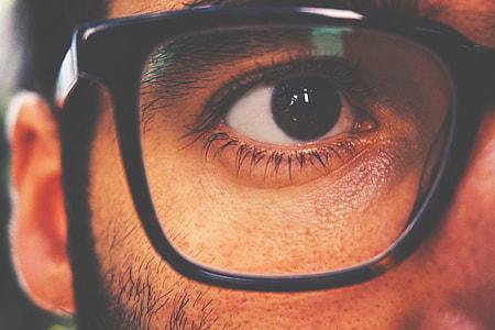 Closeup shot of a man's eye and glasses